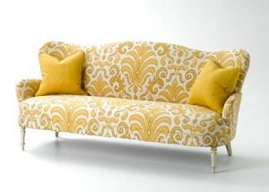 Great color and pattern on a beautifully upholstered sofa.