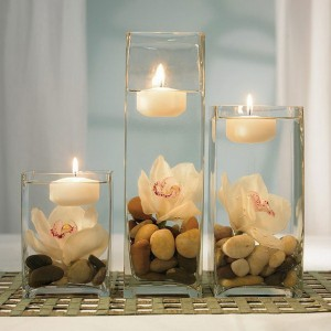 Floating candles with orchids and river rocks