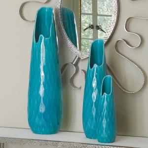 Portuguese ceramic with a reactive glaze and diamond cut design.