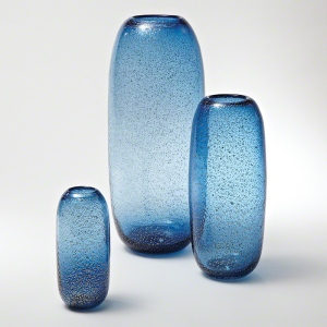 Hand blown glass with metallic flecks embedded.