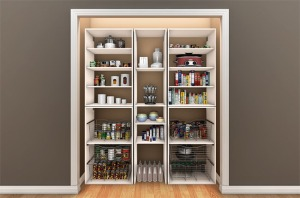 A reach in pantry with baskets and shelves.