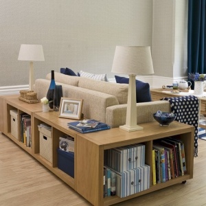 Bookcase storage doubles as sofa table.