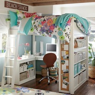 Loft bed allows for desk and bookcases below.