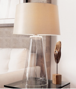 A clear glass lamp that is simple and elegant
