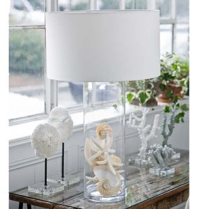 A seaside filled glass lamp