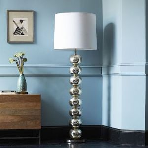 A mercury glass floor lamp for a touch of traditional and modern.