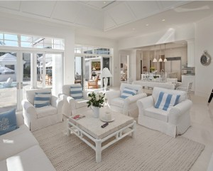 White slipcovers never go out of style on the beach.
