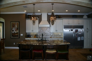 Balance a large island and high cabinets with the right light fixtures.