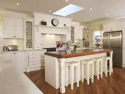 Traditional farmhouse kitchen in a refreshing white finish.