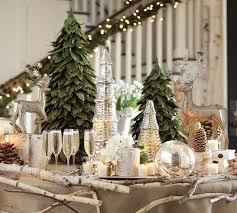 Candles mixed with crystal and greenery.